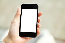 Hand holding mobile phone with blank screen.jpeg